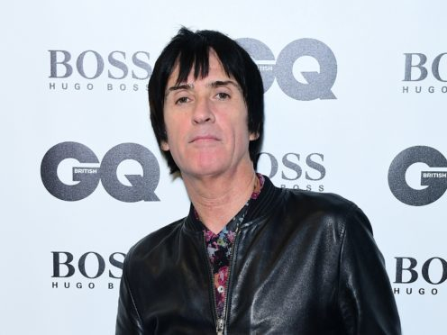 Johnny Marr has said he will never retire as he was honoured with a lifetime achievement award (Ian West/PA)