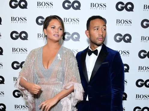 John Legend and Chrissy Teigen joke about The Voice in wedding anniversary messages (Ian West/PA)