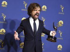 "Peter Dinklage poses in the press room with the award for outstanding supporting actor in a drama series for ""Game of Thrones"" at the 70th Primetime Emmy Awards on Monday, Sept. 17, 2018, at the Microsoft Theater in Los Angeles. (Photo by Jordan Strauss/Invision/AP)"