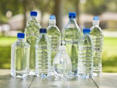 Plastic water bottles have been used to make a work accessory (AbbieImages/Getty Images)