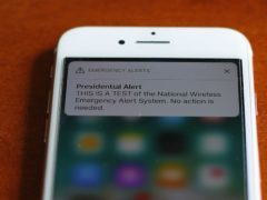 The first test of the national wireless emergency system by the Federal Emergency Management Agency is shown on a mobile phone in Detroit (Paul Sancya/AP),