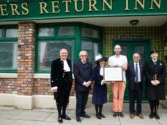 Dr Robina Shah presents the cast and crew of Coronation Street with an award (ITV/PA)