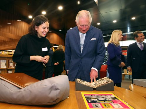 The Prince of Wales, patron of the British Film Institute (BFI), looking at archive material of actor Peter Sellers (Chris Jackson/PA)