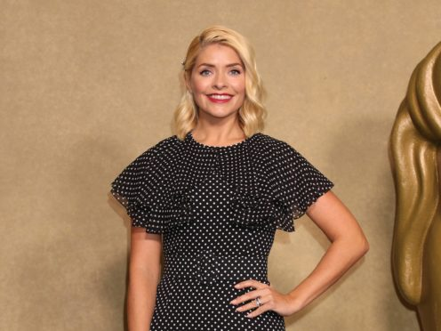 Holly Willoughby's dresses are always a hot topic on social media (Yui Mok/PA)