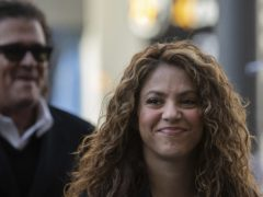 Colombian singers Shakira, right, and Carlos Vives, background, arrive at court (Bernat Armangue/AP)