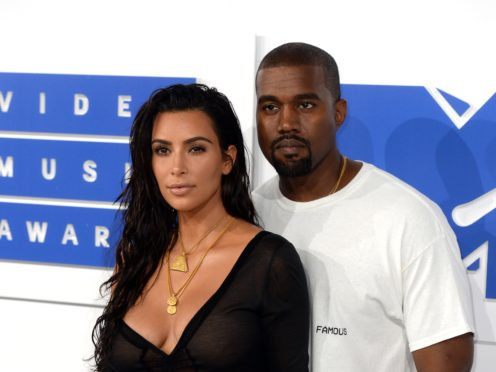 Kim Kardashian West and her husband Kanye West (PA)