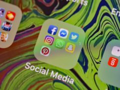 (Nick Ansell/PA)social media app icons on a smart phone.