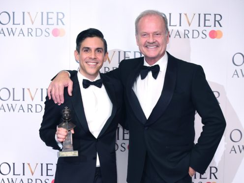 Matthew Lopez with the American Airlines Best New Play award for the Inheritance, presented by Kelsey Grammer (Ian West/PA)