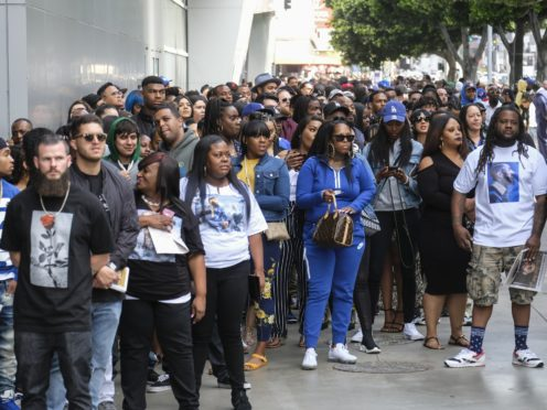 Fans of rapper Nipsey Hussle wait in line to attend a public memorial service at the Staples Center (AP)