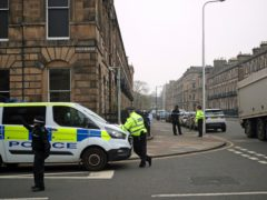 Forensic officers at the scene of the shooting in Edinburgh's west end (Jane Barlow/PA)