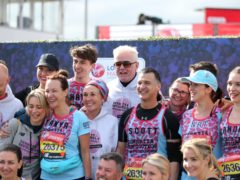 Chris Evans (centre) with the Team Barbara's Revolutionaries Jake Wood, Emma Barton, Kellie Shirley, Tanya Franks, Scott Mitchell and Natalie Cassidy prior to the 2019 Virgin Money London Marathon (Steven Paston/PA)