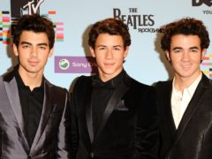 The Jonas Brothers will play Capital's Summertime Ball in London in June (Ian West/PA)