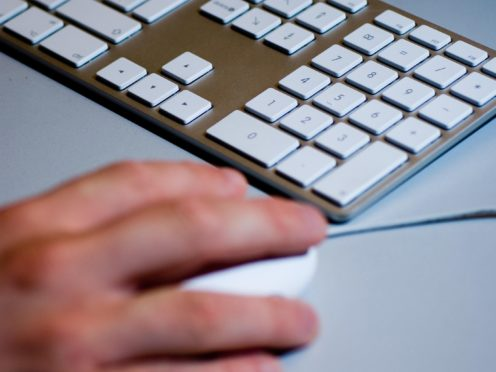 A computer mouse and keyboard (Adam Peck/PA)