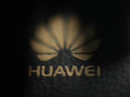 Theresa May was reported to have given the green light to Huawei to help build Britain's new 5G network (PA)