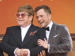 Singer Elton John and Taron Egerton (Photo by Arthur Mola/Invision/AP)