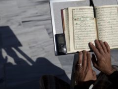 A Palestinian reads verses of the Koran during the month of Ramadan at Al Emari Mosque in Gaza City (Hatem Moussa/AP)