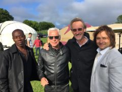 Andrew Roachford, left, with Mike + the Mechanics and Isle of Wight Festival promoter John Giddings (Ben Mitchell/PA)
