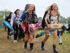 People arrive on the first day of the Glastonbury Festival at Worthy Farm in Somerset (Aaron Chown/PA)