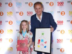 Mya Dainty and celebrity reader Hugh Bonneville at the 500 Words final (Kieron McCarron/BBC/PA)