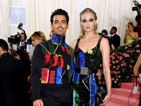Game Of Thrones star Sophie Turner has shared a picture of her and new husband Joe Jonas walking down the aisle (Jennifer Graylock/PA)