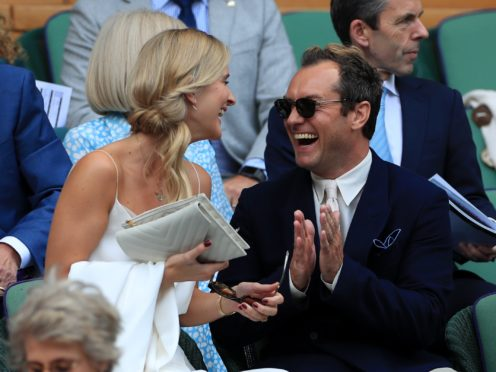 Jude Law with and his wife Phillipa on day 11 of the Wimbledon Championships (Mike Egerton/PA)