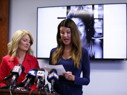 Janice Dickinson speaks at a press conference, announcing a settlement of her defamation lawsuit against comedian Bill Cosby (Katherine Campione/AP)