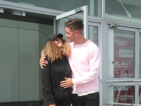 Love Island winners Amber Gill and Greg O'Shea arrive at Stansted Airport (Yui Mok/PA)