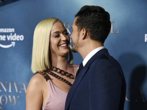 Katy Perry and Orlando Bloom in steamy red carpet PDA (Chris Pizzello/AP)