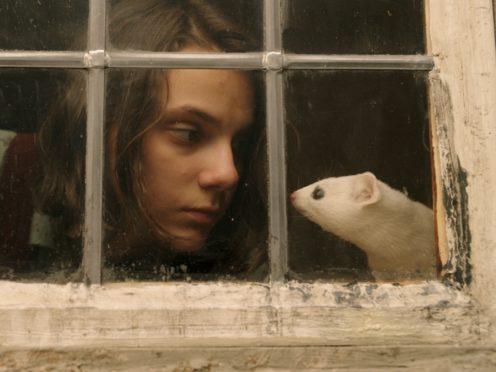 Lyra (Dafne Keene) with her daemon Pantalaimon (Bad Wolf/BBC/PA)
