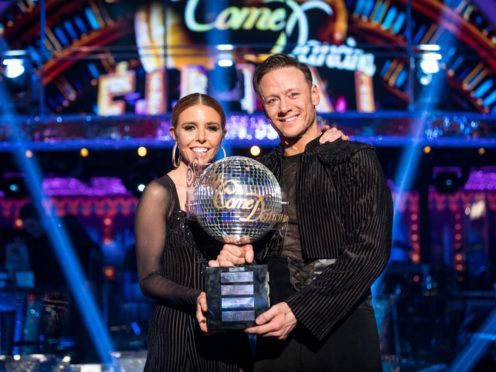 Strictly Come Dancing 2018 winners Kevin Clifton and Stacey Dooley with the glitterball trophy (Levy/BBC/PA)