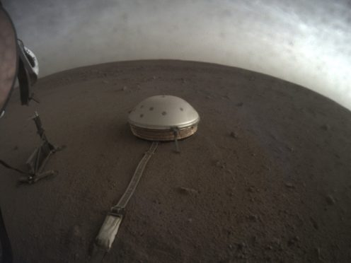 The InSight lander's dome-covered seismometer, known as SEIS, on Mars (Nasa/JPL-Caltech via AP)