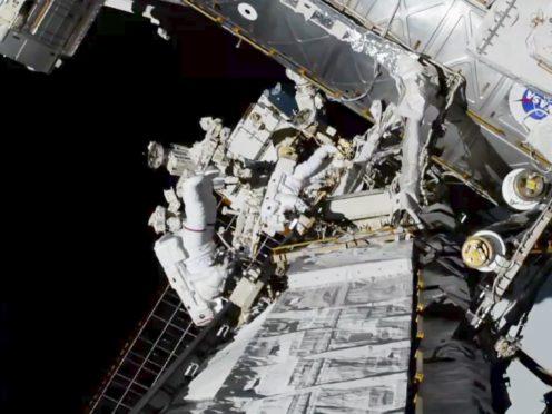 Nasa astronauts Christina Koch and Jessica Meir exit the International Space Station (Nasa via AP)