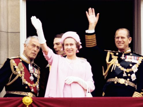 Earl Mountbatten of Burma, Queen Elizabeth II and the Duke of Edinburgh wave from the balcony of Buckingham Palace after the Silver Jubilee procession (PA)
