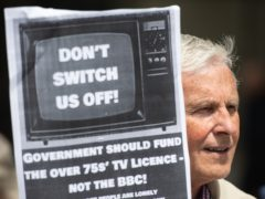 Demonstrators protest outside BBC Broadcasting House over the corporation's decision to means-test the TV licence (Dominic Lipinski/PA)