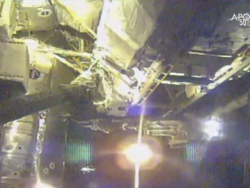 Astronauts perform maintenance on the International Space Station (Nasa via AP)
