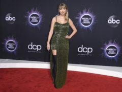 Taylor Swift and Selena Gomez were among the stars walking the red carpet at the American Music Awards (Jordan Strauss/Invision/AP)