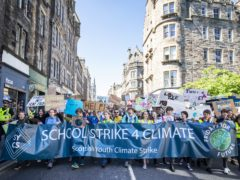 Students take part in the Scottish Youth Climate Strike, in Holyrood, Edinburgh (Jane Barlow/PA)