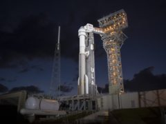 A United Launch Alliance Atlas V rocket with Boeing's CST-100 Starliner spacecraft onboard is seen illuminated by spotlights on the launch pad at Space Launch Complex 41 ahead of the Orbital Flight Test mission, Wednesday, Dec. 18, 2019 at Cape Canaveral Air Force Station in Florida. Boeing's shiny new Starliner crew capsule makes its debut this week with a launch to the International Space Station, the company's last hurdle before flying astronauts for NASA next year. (Joel Kowsky/NASA via AP)