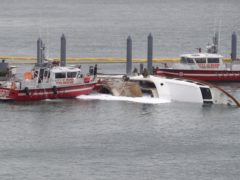 Miami Fire Rescue officials on the scene where the yacht caught fire (AP/Lynne Sladky)