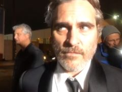 Actor Joaquin Phoenix talks at a pig vigil in Los Angeles (Jane Unchained News)