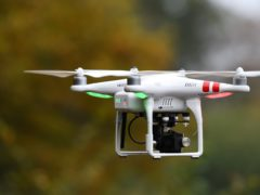 People who fly drones are required to get a separate flyer ID by passing a theory test (Joe Giddens/PA)