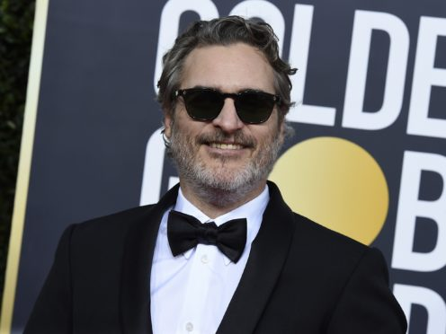 A US TV host has apologised to Joker star Joaquin Phoenix after appearing to mock a scar on his upper lip (Jordan Strauss/Invision/AP, File)