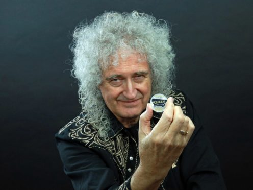 Queen guitarist Brian May with the Queen 2020 UK £5 brilliant uncirculated coin (The Royal Mint/PA)