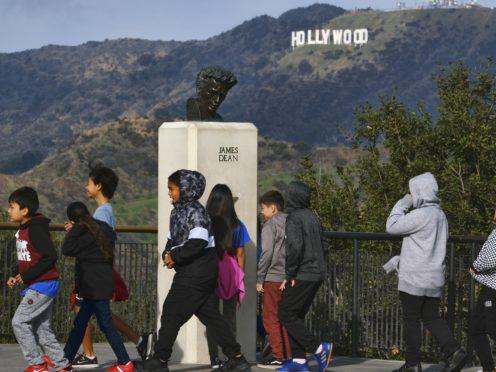 School children walk past a bust of actor James Dean during a field trip (Richard Vogel/AP)