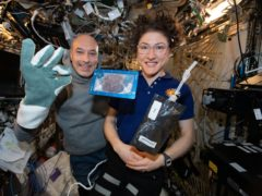 Astronaut Christina Koch with space station commander Luca Parmitano (Nasa/AP)