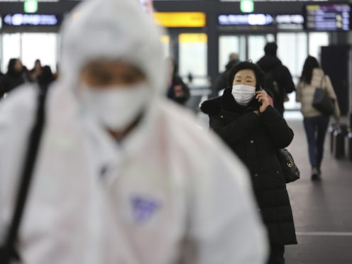 The virus outbreak has been linked to a seafood market in Wuhan, China (Ahn Young-joon/AP)