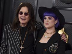 Ozzy Osbourne walked the red carpet at the 62nd Grammy Awards with the aid of a cane (Jordan Strauss/Invision/AP)