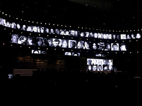 Members of the music community are remembered during an in memoriam tribute at the 62nd annual Grammy Awards (Matt Sayles/Invision/AP)