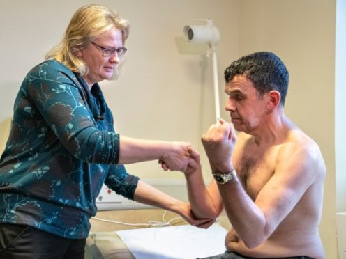 Prof Zosia Miedzybrodzka with patient Sandy Patience (University of Aberdeen/PA)
