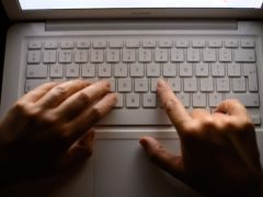 File photo dated 06/08/13 of a woman's hands using a laptop keyboard.